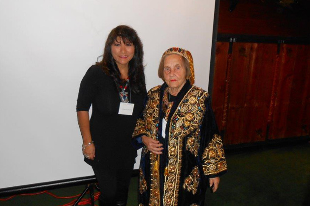 Speaker Lillie Echevarria (left) with Betty Knudson wearing an Uzbek dress