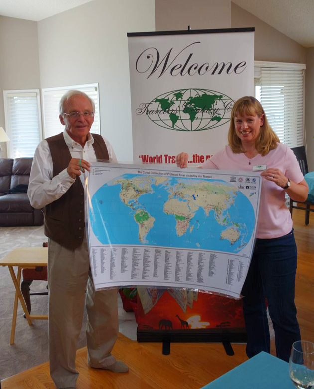 Guest speaker, Jim Thorsell, UNESCO and IUCN, together with Lana Skeet, holding a map of the UNESCO sites he has inspected and visited.