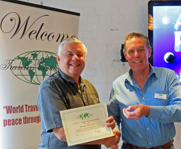 Chapter Coordinator Rick Shaver (right) presents a 100 country certificate to Doug Storey,