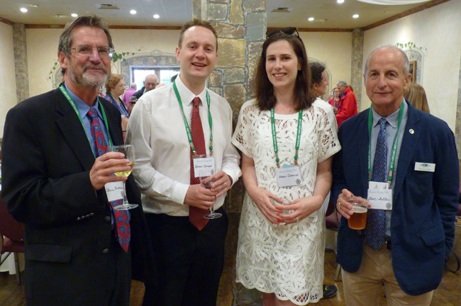 Board members Chris Hudson (l) and Steve Fuller (r) meet New Zealanders George Chitidden and Frances Griffiths, who stopped by on their way to Sweden