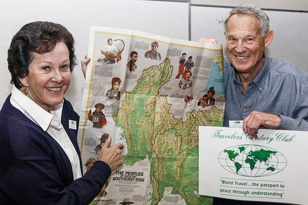Buzz and Beverly Nason, who gave the Arizona presentation in February, are holding a map of the Peoples of Southeast Asia.