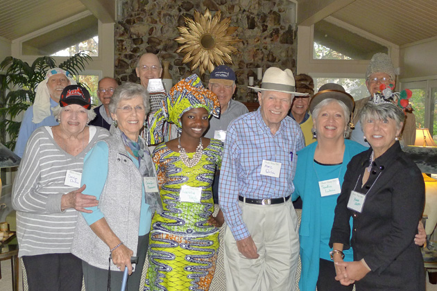 Arkansas members and guests sporting hats from around the world at the November 2013 Arkansas Chapter meeting. Back row, left to right: Steven Clift (in keffiyeh Arabic headgear), guest Phil Cromer, Dennis Grandle (Burma), Dick Brannon (New Zealand), Aaron (Russia), Charles Merkle (Afghanistan); front row, left to right: Carolyn Oudin (Cuba), CoraLee Brannon (guest speaker from the Clinton school of Public Service), Laetitia Tokplo-Benin (traditional dress), Marc Oudin (Panama hat) and Sandi Lubin (Ecuador).