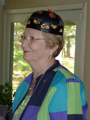 Irene Gray models a hat from China at the November 2013 Arkansas gathering.