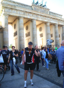 Rick Shaver (pictured front and center in Berlin) says the Berlin marathon finishers get to run through the Brandenburg Gate, with much of the run taking place near or on the location of what was the Berlin Wall.