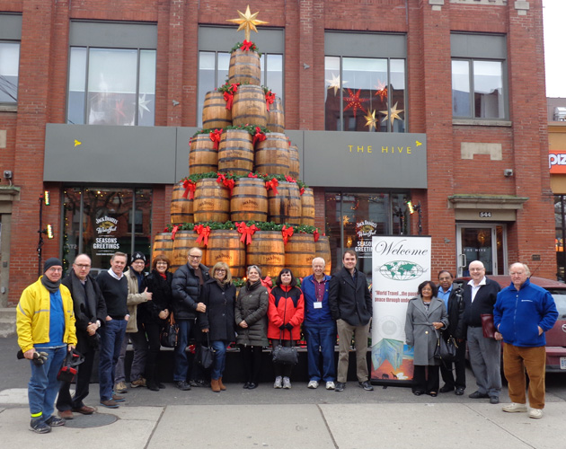 A group picture was taken in front of the Hive's Jack Daniel's barrel tree.