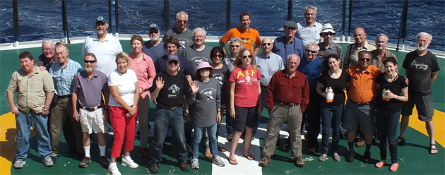 About 30 TCC members joined a cruise from Ushuaia to Cape Verde, centered on a stop at Bouvet Island, but turbulent seas made landing impossible. Though the sea was rocky, these TCC members posed for a group photo — (front row): Mike Bidwell, Don Parrish, Jacquelyn Jerry, Neal Pollock, Laurie Campbell, TCC Treasurer JoAnn Schwartz, Dominique Laurent, Wendy Arbeit, Jagannathan Srinivasaraghavan, Michelle Arbeit; (middle row): Bob Ihsen, Bob Bonifas, Karin Singer, Joao Peixoto, Ed Reynolds, Cathy Parda, Beverly and Harold Griffith, Valentin Sazhin; (back row): Lynn Bishop, Rolf Scheidel, Bob Parda, Phillips Connor, Don Fillman, Dan Walker, Lemut Lent, Harry Mitsidis, Steve Newcomer, Frank Rainer. Those not pictured: William Baekeland, Diana Boyer, Elliot Koch, Carole Ann Peskin, Frank Robinson.