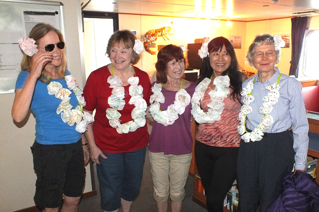 The ships's bartender promised Pina Coladas one day at sea so the ladies improvised flower leis, using tissues and duct tape. Pictured: JoAnn Schwartz, Diana Boyer, Laurie Campbell, Cathy Parda, Beverly Griffith.