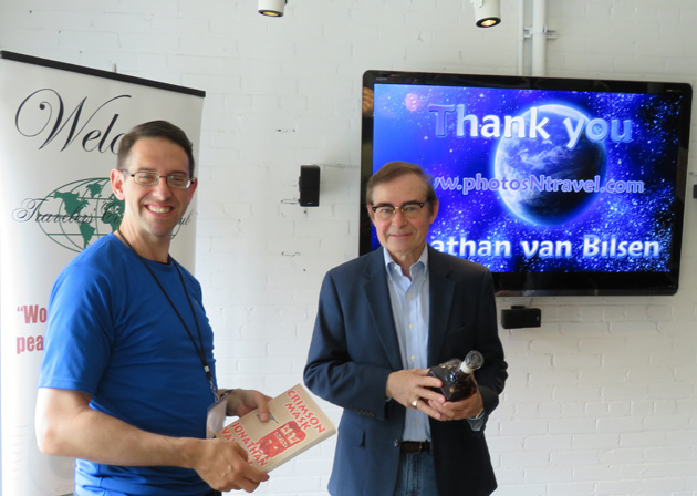 Colin Stephenson (left) presenting a thank you gift to speaker Jonathan Van Bilsen