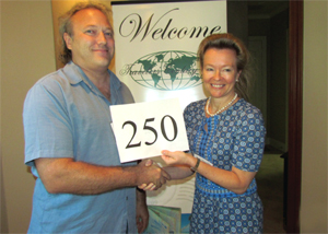 Outgoing Texas coordinator Kim-Kay Randt congratulates Jordan Hargreave for reaching his 250th country.